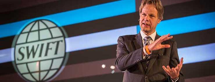 SWIFT-CEO Gottfried Leibbrandt begruesst die SIBOS-Teilnehmer.SWIFT