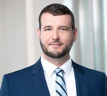 Patrick Smith, Rechtsanwalt / Assoziierter Partner bei GÖRG kennt sich genau mit Utility Token aus!