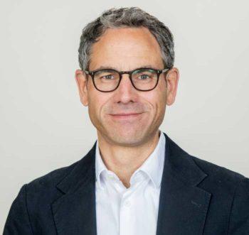 Roland-Adrian, Geschäftsführer bei Verimi<q>Verimi